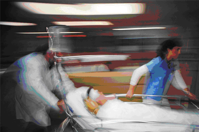 Doctors rushing Personal Injury Victim into Hospital