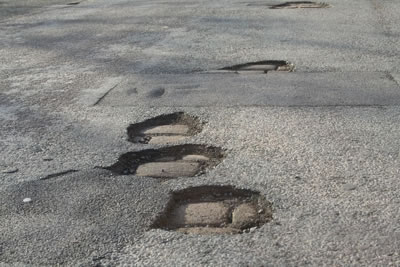 Potholes in street are a bikers worst nightmare