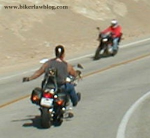 California Biker Lawyer Norman Gregory Fernandez riding around a curve on Mulholland Highway