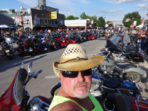 California Motorcycle Accident Attorney Norman Gregory Fernandez at the Sturgis Motorcycle Rally on the main drag, August 3, 2013