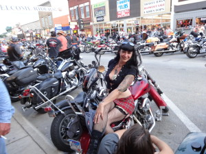 Beautiful Lady on a motorcycle in downtown Sturgis at the 2013 Sturgis Motorcycle Rally