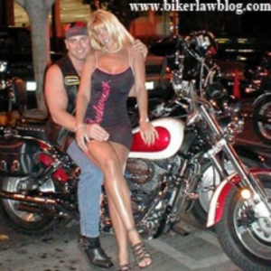 Farmersville motorcycle accident lawyer norman gregory fernandez with special friend at universal studios in studio city