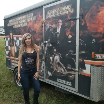 Little Teri next to Biker Lawyer Norman Gregory Fernandez trailer sturgis 2017