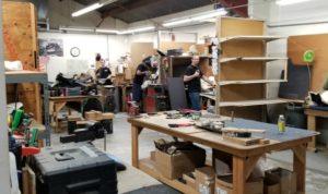 craftsmen inside factory making custom seats